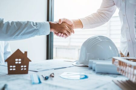 Team Engineer colleagues shaking hands and meeting for architectural project on workplace