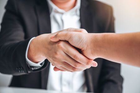 Business team shaking hands during a meeting Planning Strategy Analysis Concept Banco de Imagens