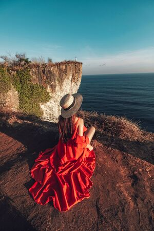 Couple Adventure and looking view on the karang boma cliff at Uluwatu Bali in Indonesia Banco de Imagens - 130737317