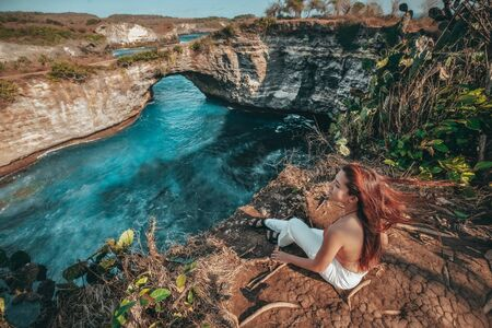 Travel woman looking view of broken beach, Nusa Penida island Bali, Indonesia Banco de Imagens - 130735783