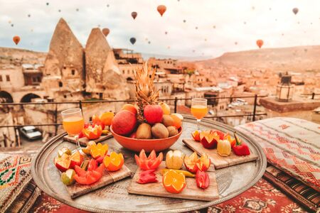 Travel in Cappadocia Colorful hot air balloons flying over the valley sunrise time with special breakfast travel destination in Turkey Banco de Imagens - 130736931