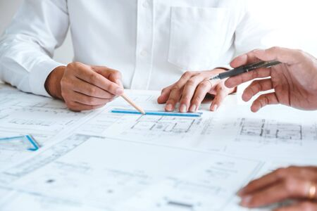Team Engineer drawing graphic planning and meeting for architectural project on workplace Banco de Imagens - 136189853