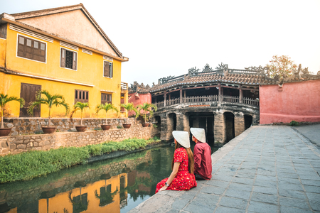 Travel couple with Japanese Covered Bridge, in Hoi An, Vietnam