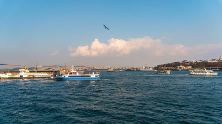 View of Istanbul cityscape Galata Tower with floating tourist boats in Bosphorus ,Istanbul Turkey Banco de Imagens - 130701978