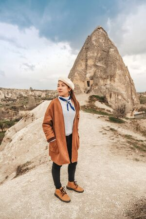 Travel woman with Landscape of Goreme fairy chimneys , Cappadocia. Nevsehir Province. Turkey. Banco de Imagens