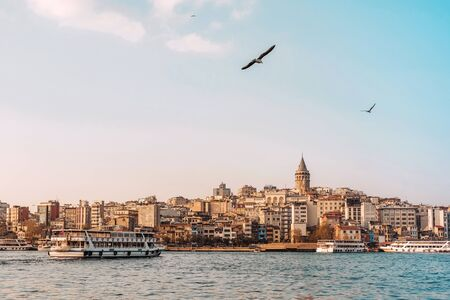 View of Istanbul cityscape Galata Tower with floating tourist boats in Bosphorus ,Istanbul Turkey Banco de Imagens - 137046847