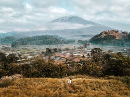 Aerial view of landscape Couple with Terrace rice field of Mount Agung volcano in Bali in Indonesia