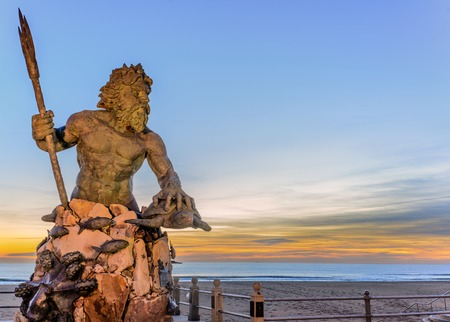 greek gods: Statue of King Neptune in Virginia Beach  Taken just before sunrise
