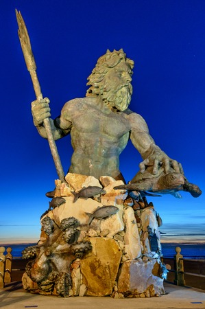 king neptune: Statue of King Neptune in Virginia Beach  Taken just before sunrise