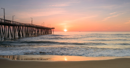 docks: Sunrise view next to the 14th st. fishing pier located in beautiful Virginia Beach, Va.