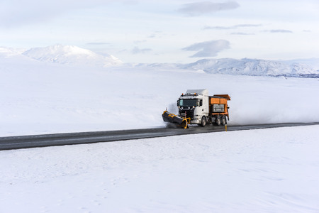 A snowplow clearing Icelands Ring Road. The snowplows are out clearing the roads very quickly during and after a storm Zdjęcie Seryjne