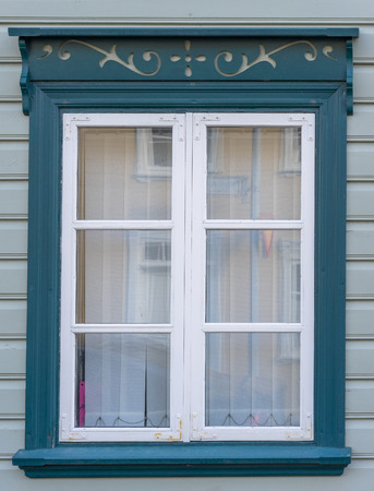 white trim: A blue window with white trim on a house in Reykjavik Iceland Stock Photo