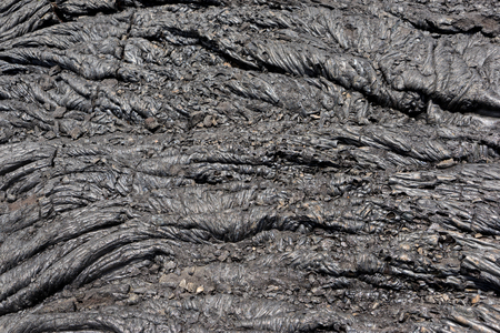 stone volcanic stones: Black lava and the swirling  design that it made when cooling.
