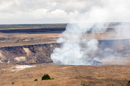 The crater of Mt. Kilauea inside the large caldera. Located in Volcanoes National Park, Hawaii. Фото со стока - 58725523