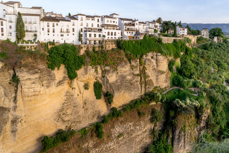 Buildings on the edge of the cliff that overlooks the El Tajo ravine in Ronda Spain. Stock Photo