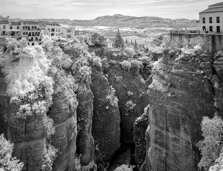 The El Tajo ravine on the north side of the New Bridge in Ronda Spain.