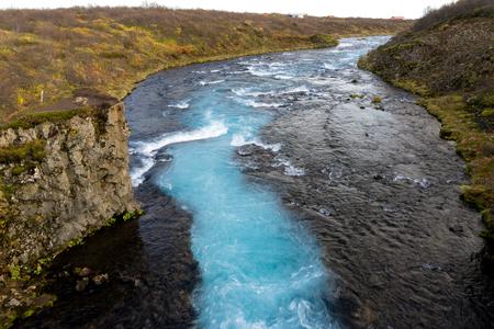 downstream: Looking downstream from the beautiful Icelandic waterfall Bruarfoss Stock Photo