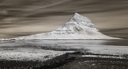 Kirkjufell (463m) is a beautifully shaped and a symmetric, free standing mountain. Its name means Church Mountain.