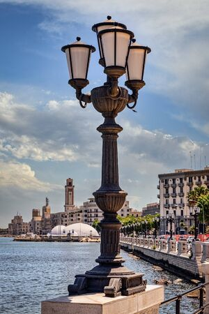 Streetlamp at the waters edge in Bari, Italy