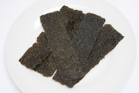 alga: Algae on white dish