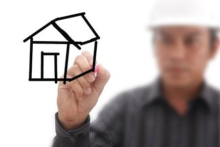 한 남자가 집을 그리다.