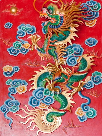 Dragon statue on red background photo