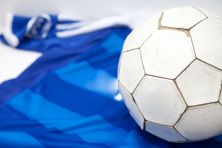 Football on blue shirt background photo