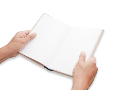 A hand is opening blank page notebook photo