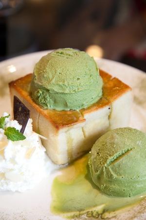 Green tea icecream with bread photo