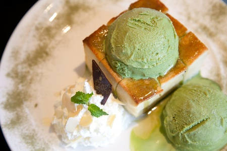 Green tea icecream with bread photo