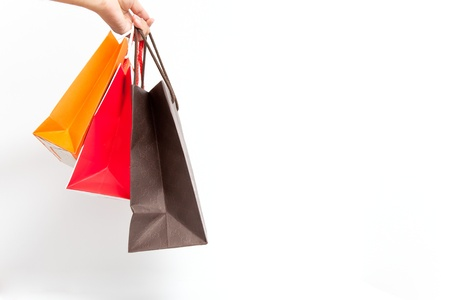 Holding shoping bags by hand on white isolate Stock Photo - 13214159