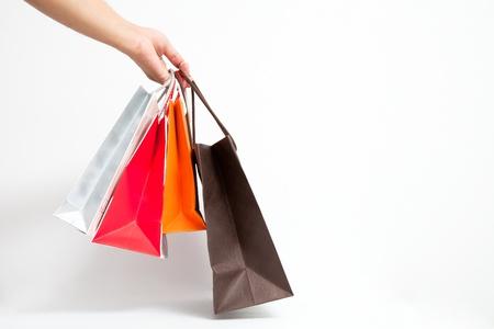 흰색 격리에 손으로 shoping 가방을 들고 스톡 콘텐츠