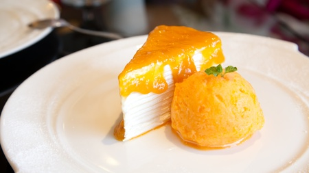 Orange cake with an icecream photo