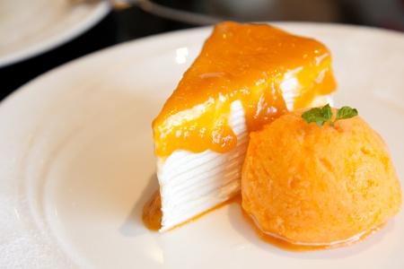 Orange cake with an icecream photo