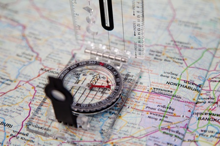 Compass on a map for travel photo