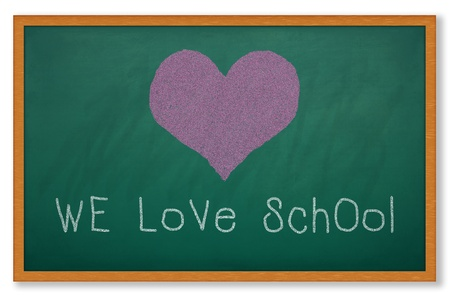 Heart shape on grunge green chalkboard and worlding WE LOVE SCHOOL photo