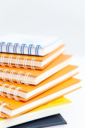notebook stack on white isolated photo