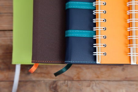 notebook stack on wood background Stock Photo - 13462987
