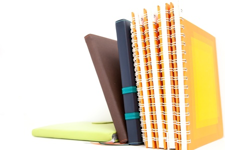 notebook stack on wood background Stock Photo - 13704359