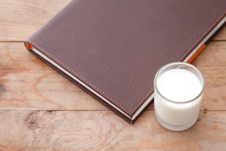 Book and milk on the table Stock Photo - 14512637