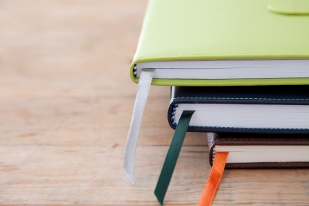 Notebook stack on wood table photo