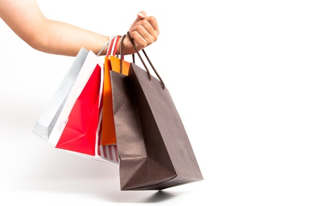 Holding shoping bags by hand on white isolate Stock Photo - 14512664