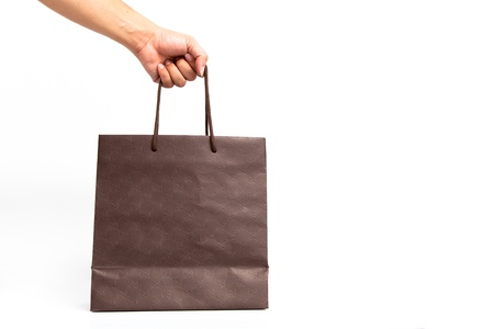 Holding shoping bags by hand on white isolate photo