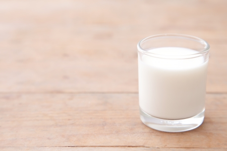 glass of milk: Milk on wood table background Stock Photo