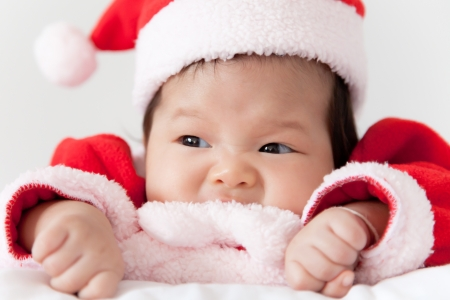 Little girl with santa costume photo