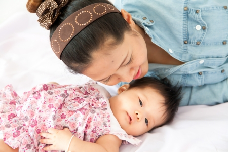 Mom is enjoying with her baby Stock Photo