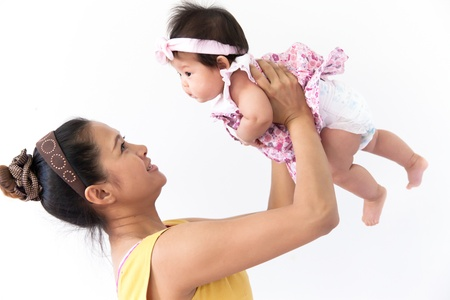 Mom is enjoying with her baby Stock Photo - 17159504