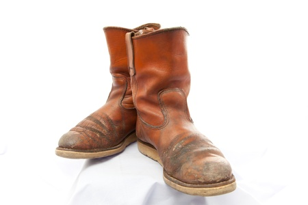 Brown boot shoes for men on white background photo