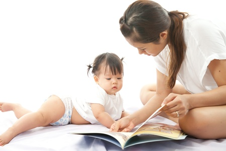 Mother is reading a book for her baby Stock Photo - 19838086