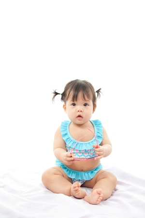 Portrait baby girl in swimsuit on white background photo